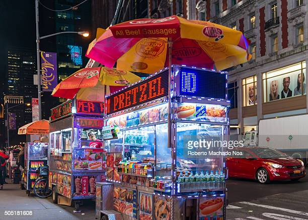 Street food in New York City Mobile food carts lined up to sell delicious and wide range of items like hot dogs pretzel Italian sausage kebabs etc A...