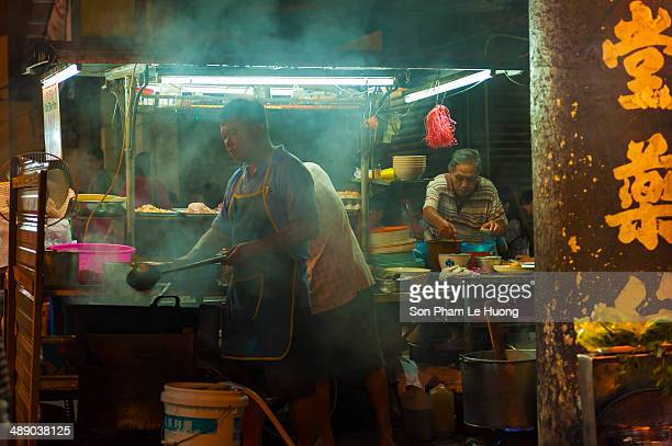 CONTENT] Street food vendor at his noodle stall in Lebuh Chulia Penang Malaysia