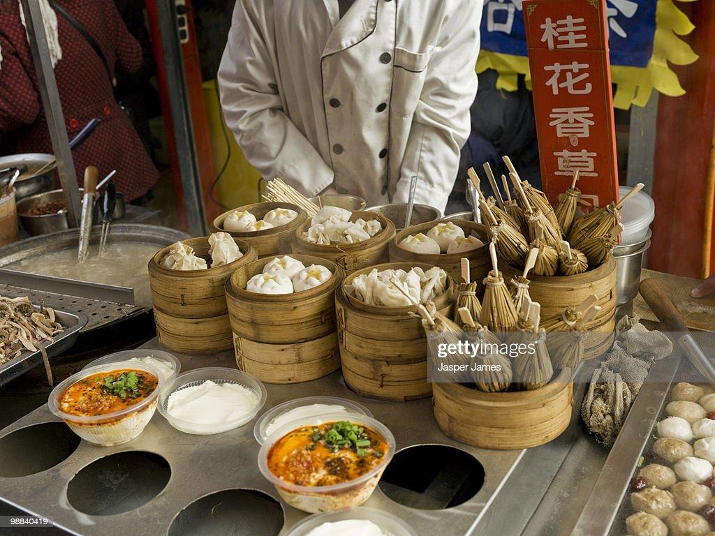 Street food vendor at Wangfujin food market,Beijin : Stock Photo