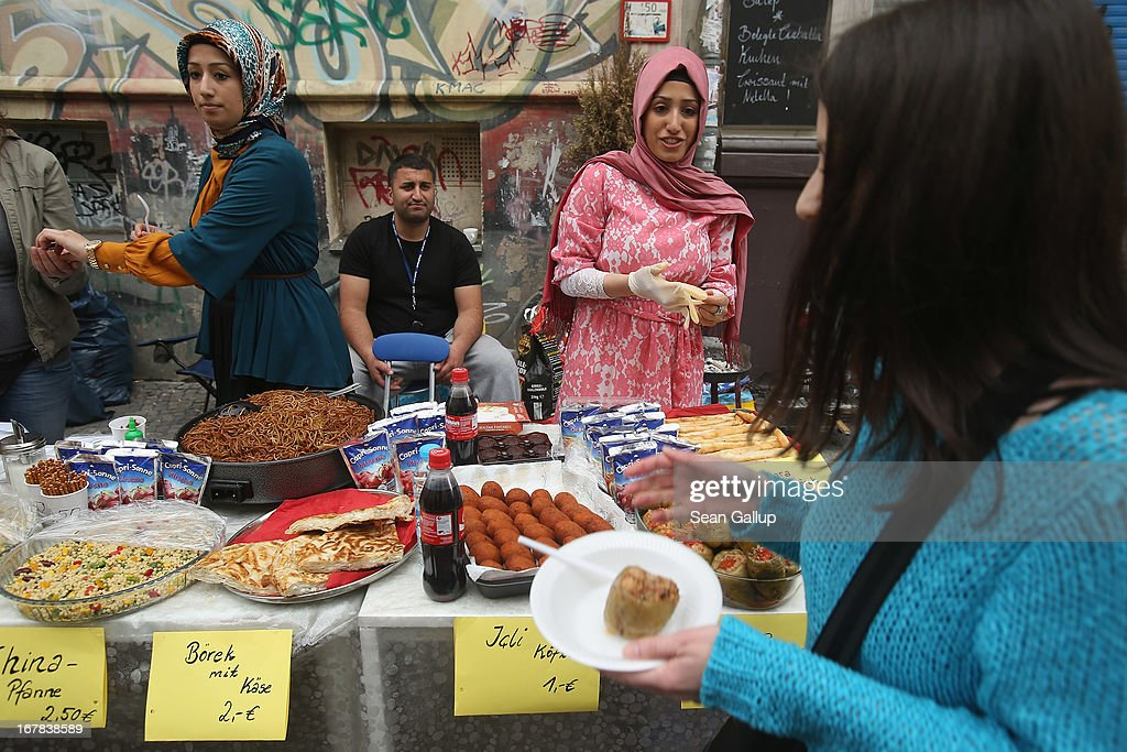 Street food vendors sell Turkish food at the MyFest street food and music fest in immigrant-heavy Kreuzberg district on May Day on May 1, 2013 in Berlin, Germany. May Day, the international day of labour, is a national holiday in Germany and observed with gatherings by labour unions and political parties. In some cities, including Hamburg and Berlin, the day often ends with violent clahes between police and mostly left-wing demonstrators.