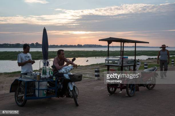 Street food vendors wait for customers on a promenade along the Mekong river in Vientiane Laos on Thursday Nov 2 2017 Located in the Mekong region...