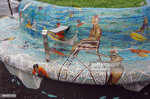 Street furniture on Campbell Parade featuring mosaics depicting surfers riding the waves and surf lifeguards in Bondi Beach Sydney New South Wales...