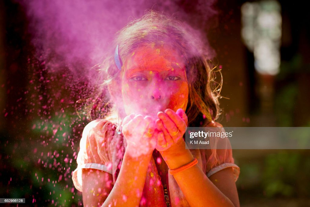 UNIVERCITY, DHAKA, BANGLADESH - : A street girl attend celebrate the Holi Festival or Festival of Colors after smearing each other with colored powder in Dhaka, Bangladesh. Holi festival is celebrated on the full moon day in the month of Phalguna and marks the start of the spring season.