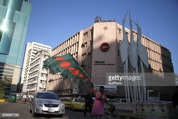 A street hawker carries national flags of Bangladesh for sell to customer during the victory month of December in Dhaka Bangladesh on December 8 2016...