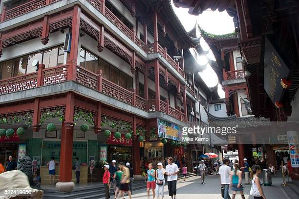 Street in amongst the traditional Chinese architecture of Yu Yuan Garden This area draws a lot of tourists both mainland and western to its tea jade...