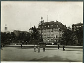 A street in Hamburg Germany with a view of City Hall and Kaiser Wilhelm monument