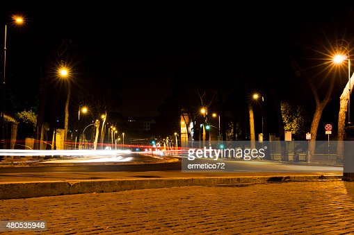 street in Rome at night with light trails : Stock Photo
