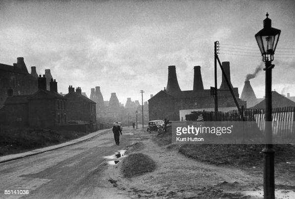A street in StokeonTrent Staffordshire with bottle kilns belonging to potteries visible in the background 2nd March 1946 Original publication Picture...