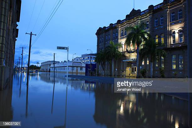 A street in the city centre is partially covered by floodwaters on January 5 2011 in Rockhampton Australia All eyes are on the central Queensland...