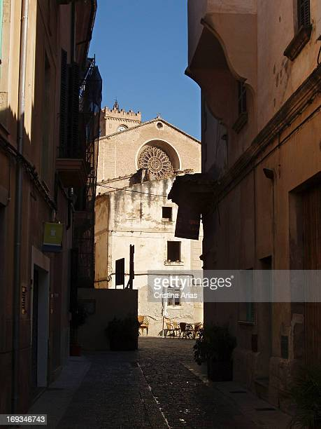 A street in the old town of Pollensa with the church of Mare de Deu del Angels in the background Majorca Island Balearics Islands Spain