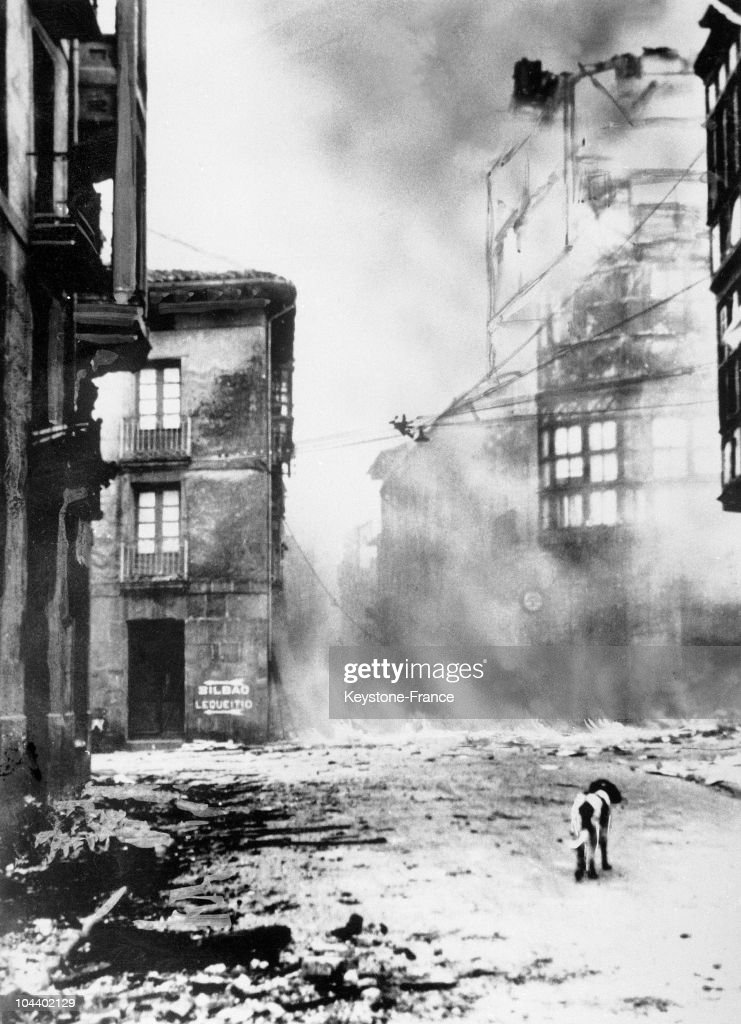 A street in the Spanish town of Guernica after German bombing and the victory of the Nationalist rebel troops. A dog wandering through the ruins is the only sign of life.