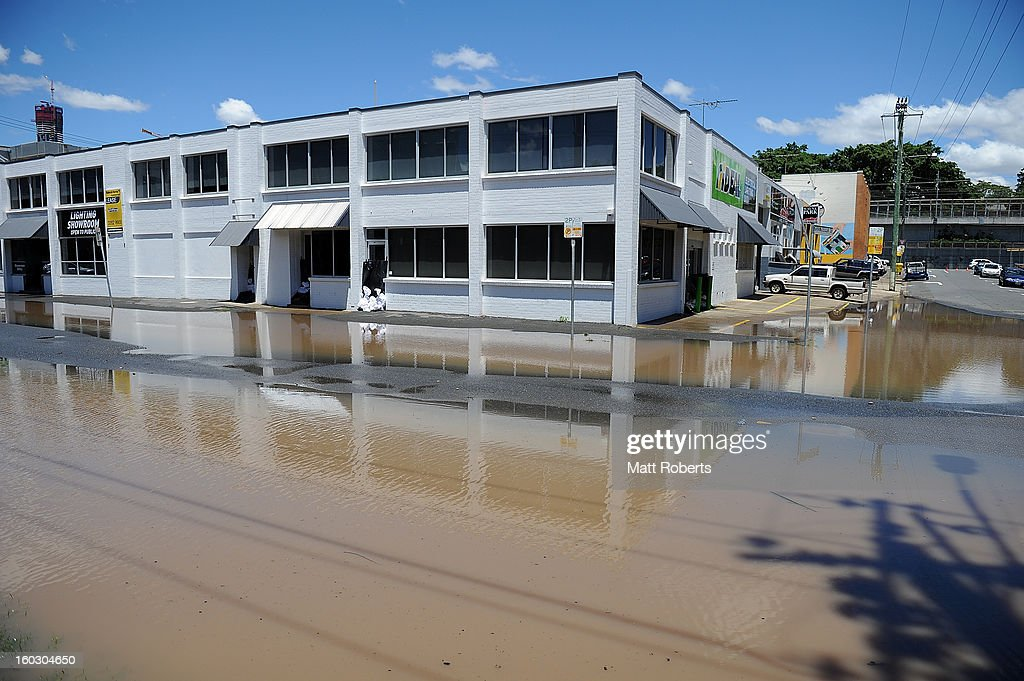 A street is seen flooded in the inner city suburb of Milton as parts of southern Queensland experiences record flooding in the wake of Tropical Cyclone Oswald on January 29, 2013 in Brisbane, Australia. The river in the Brisbane CBD is expected to peak at 2.3 metres today - lower than the 2.6 metre peak predicted - but is still likely to flood low-lying properties and businesses. The flood crisis has claimed four lives so far, with the city of Bundaberg, Queensland faces the worst flooding in its history.