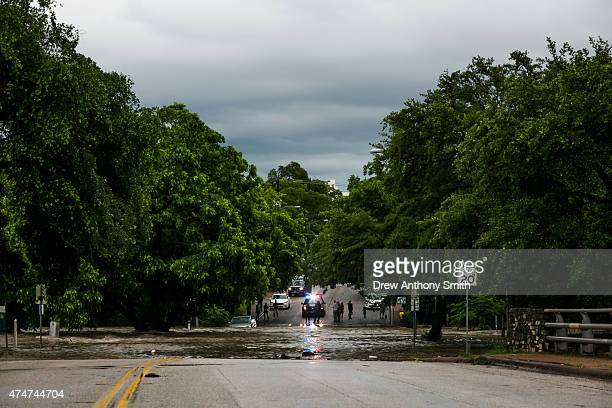 A street is shown partially submerged after days of heavy rain on May 25 2015 in Austin Texas Texas Gov Greg Abbott toured the damage zone where one...