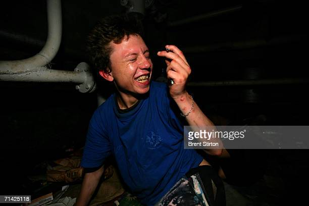 A street kid laughs in a damp filthy underground cellar on August 21 2005 in Odessa Ukraine All of the 6 kids in the cellar are HIV positive and many...