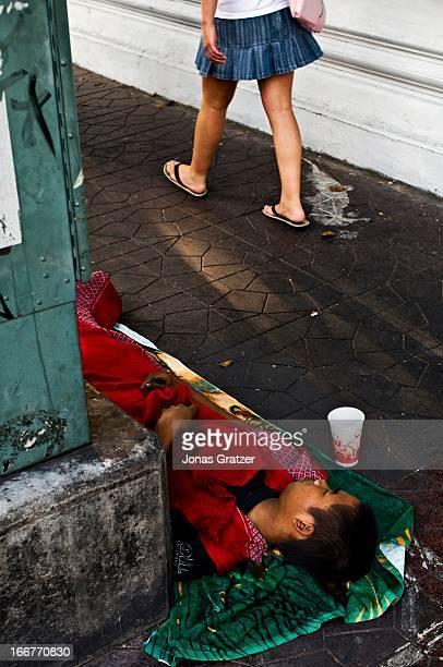 A street kid sleeping in the tourist area around Khao San Road in Bangkok