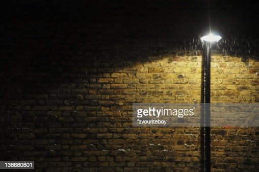 Wall Street S Bright Lights : Street Lamp By Brick Wall At Night Stock Photo Getty Images
