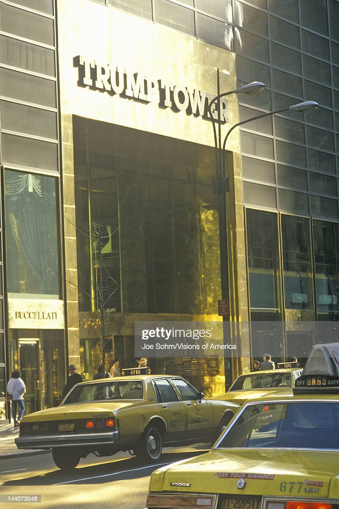 Street level entrance to Trump Tower with taxis New York City NY