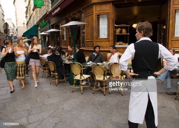 Street life along Rue Vieille du Temple in the Marais area.