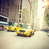Street life in Manhattan with yellow cabs
