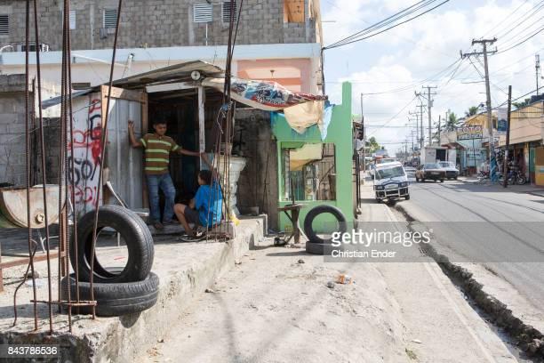 Santa Domingo Dominican Republic November 30 2012 Street life in the poor neighbourhood 'Los Alcarrizos' in Santa Domingo people are talking with...