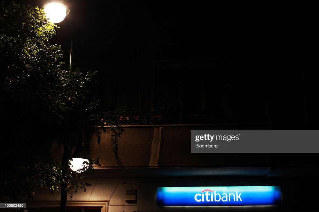 Street lights illuminate a closed Citibank branch, operated by Citigroup Inc., in central Athens, Greece, on Thursday, Nov. 22, 2012. Citigroup Inc., the third-biggest U.S. bank by assets, said it will shutter almost half of its branches in Greece as European lawmakers continue a three-year struggle to fix the country's economy. Photographer: Angelos Tzortzinis/Bloomberg via Getty Images