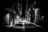 Australia, Canberra, Acton, Street lights illuminate alley at night time.