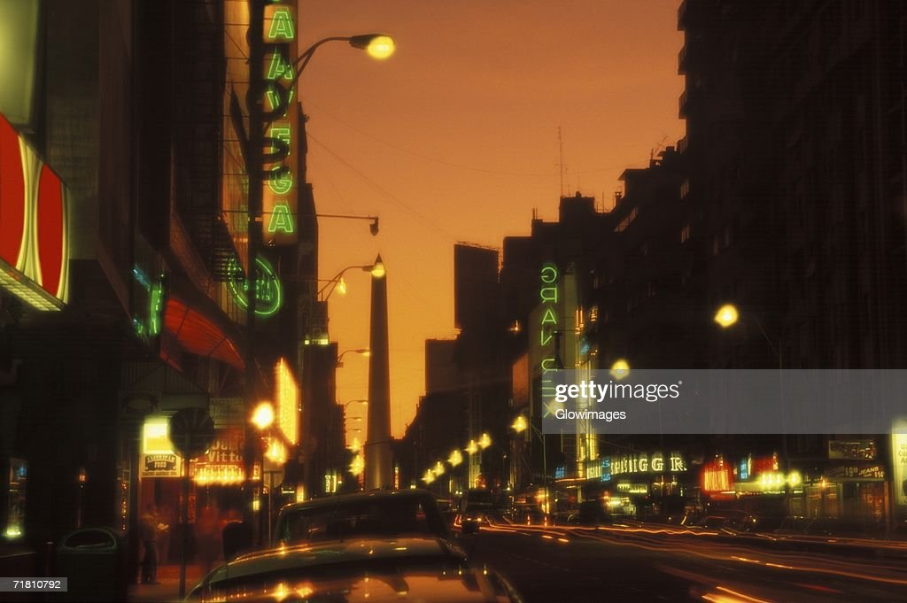 Street lights lit up at night : Stock Photo