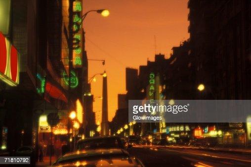Street lights lit up at night : Stock Photo