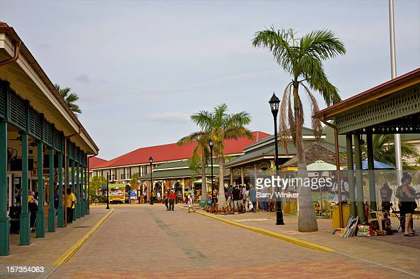 Street lined with colorful shopping colonnade.