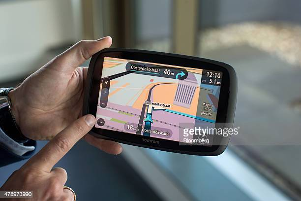 A street map is displayed on the touchscreen of a TomTom GO 6100 personal navigation device at TomTom NV's headquarters in Amsterdam Netherlands on...