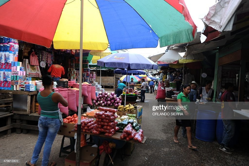 Street market vendors offer fruits and vegetables in Las Americas market in Tegucigalpa on May 8 2015 Some market vendors had to leave their business...