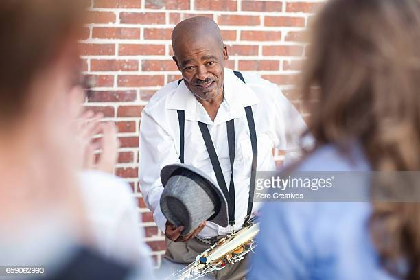Street musician bowing to crowd
