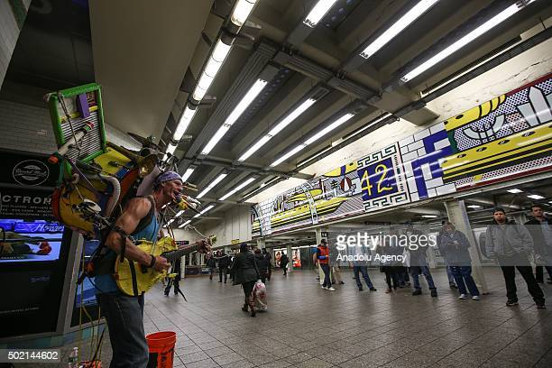 A street musician performs in the New York subway on December 21 2015 in New York City NY United States The street musicians who perform on the...