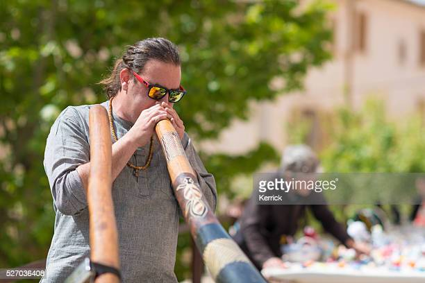 Street musician playing didgeridoo at city market day Sineu Mallorca