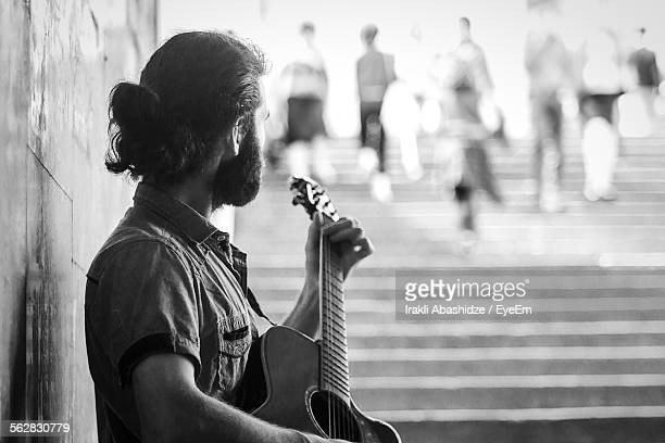 Street Musician Playing Guitar