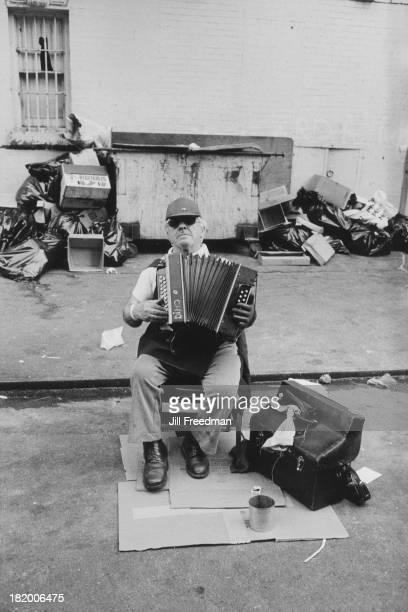 A street musician plays the accordion in New York City 1983