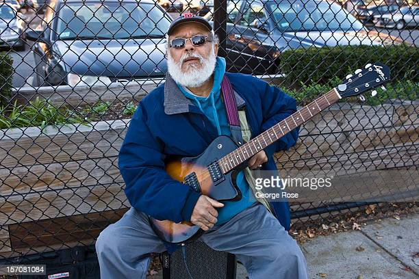 A street musician plays the blues on his guitar in the North End on November 4 2012 in Boston Massachusetts Despite a global recession that has...
