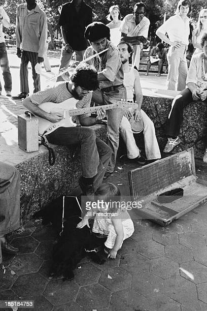 Street musicians attract a crowd in Washington Square Park New York City 1977