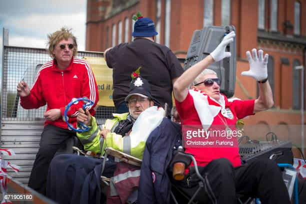 Street musicians Garry Stanley and The Piccadilly Rats take part in the Manchester St George's Day parade ton April 23 2017 in Manchester England...