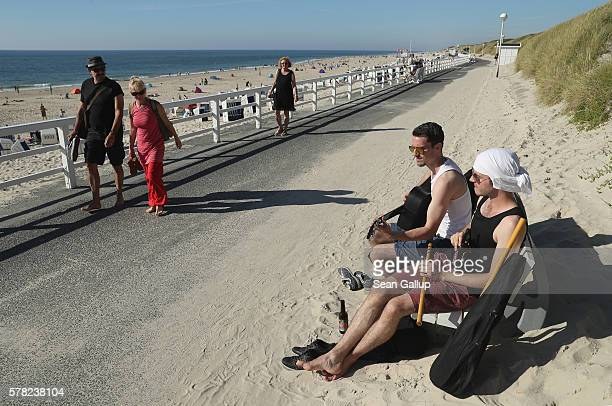 Street musicians play along the boardwalk on a beach on Sylt Island on July 19 2016 near Wenningstedt Germany Sylt Island with its long stretches of...