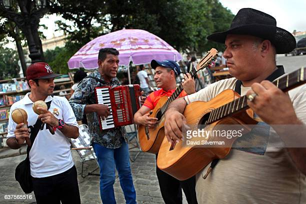 Street musicians play for tourists at the Plaza de Armas market on December 18 2015 in Havana Cuba The square in ciudad vieja Habana or Havana's old...