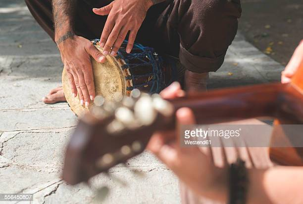 Street musicians playing guitar and drum