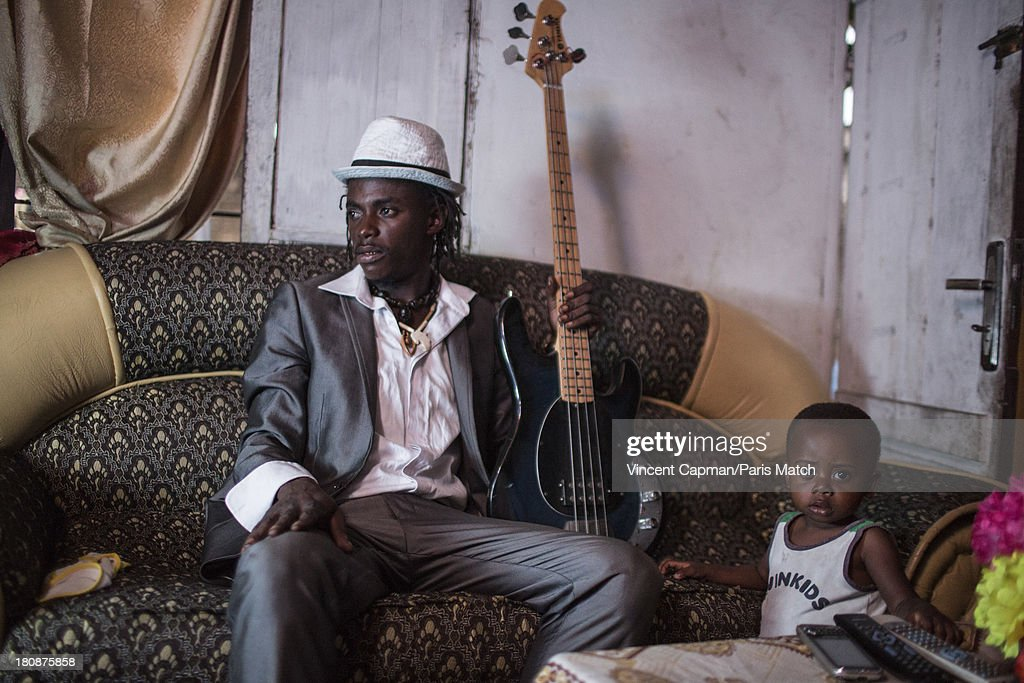 Street musicians Staff Benda Bilili are photographed for Paris Match on August 27, 2013 in Kinshasa, Democratic Republic of Congo.
