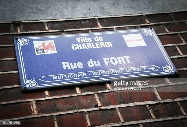 A street name sign is pictured on a wall at the Rue du Fort street in Charleroi Belgium on January 13 2016 Belgian police have found two apartments...