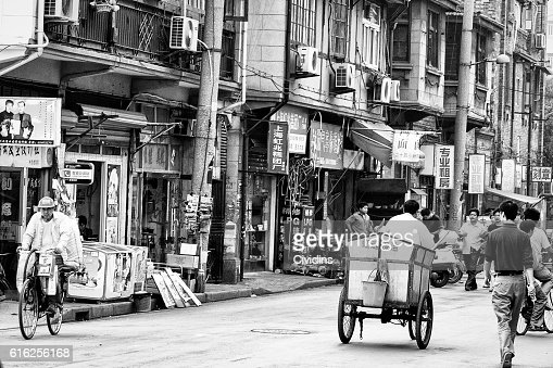 Street of Shanghai, China, with shops and people : Foto de stock