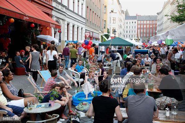 Street Party in the Bergmannstrasse in Berlin Kreuzberg people in a pavement cafe