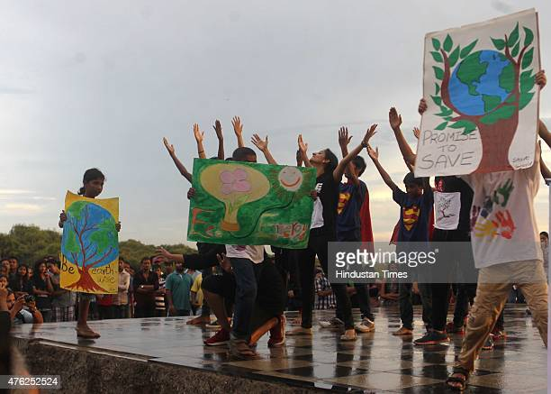 Street performance by Dance True Initiative on Save Environment around the theme of RecycleReuseReduce during rain at Bandra Carter Road on June 7...