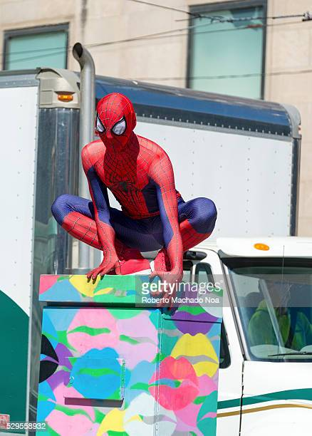 Street performer busker in Dundas Square Man dressed as Spiderman from the Marvel comics sitting on top electrical box The Toronto council is...