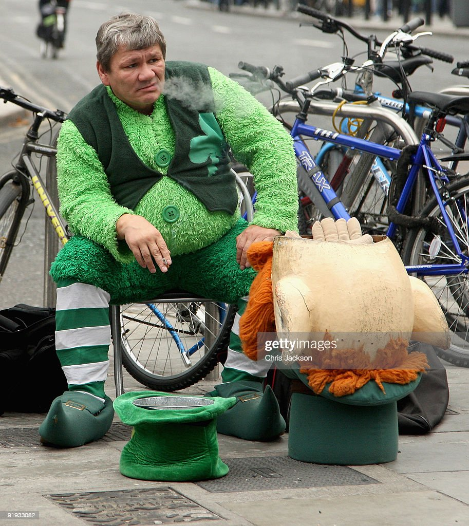 A street performer dressed as a leprechaun smokes a cigarette as he takes a break on October 15, 2009 in Dublin, Ireland. Dublin is Ireland's capital city, located near the midpoint of Ireland's east coast, on the River Liffey. It is a vibrant city with a thriving music scene and has been voted one of the top 25 cities of the world to live in. Irish President Mary McAleese signed the European Union's Lisbon treaty today, two weeks after voters approved the Lisbon Treaty in a controversial referendum.