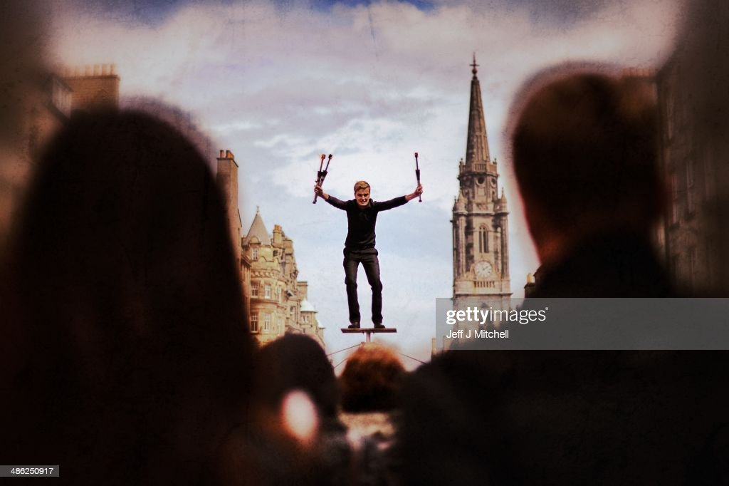 A street performer entertains a crowd on the Royal Mile on April 23, 2014 in Edinburgh, Scotland. A referendum on whether Scotland should be an independent country will take place on September 18, 2014